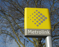 Sign Metrolink Station. Manchester, England, March 30: The destinctive yellow Metrolink sign and emblem found at all tram stations in Manchester, England, in Royalty Free Stock Images