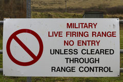 Sign Military Firing Range No Entry. Red UK Army warning sing, Military Firing Range No Entry, Unless Cleared Through Range Control Stock Photography