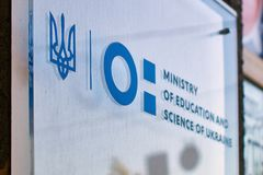 Sign of the Ministry of Education and Science of Ukraine with the new logo on the official building. Kyiv, Ukraine - June 8, 2018: Sign of the Ministry of stock photos