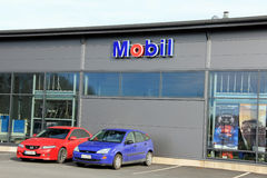 Sign Mobil on a Shop Wall with Red and Blue Cars Royalty Free Stock Photos