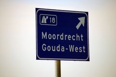 Sign at the motorway for a junction in the netherlands to the towns Gouda and Moordrecht along A20.  royalty free stock image