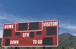 Sign Mountain. A football scoreboard with a small mountain in the background Royalty Free Stock Image