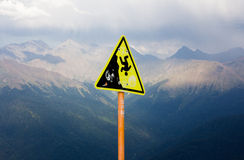 A sign in the mountains. Dangerous. Stock Photo