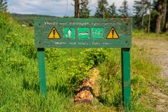 Sign: Multi-use track, take care English & Welsh royalty free stock photo