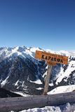 Sign with the name of city Karakol and height of mountain Royalty Free Stock Photography