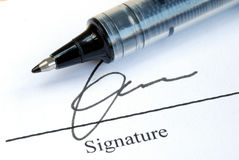 Sign the name on a paper Stock Image
