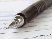 Sign the name on a paper with a pen. Stock Photo