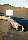 Sign near old rotting pipe - ecological disaster Royalty Free Stock Images