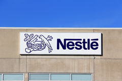Sign Nestle with Blue Sky. TURKU, FINLAND - OCTOBER 6:  Nestle Factory on October 6, 2013 in Turku, Finland. Nestle S.A. is a Swiss multinational food and Royalty Free Stock Image