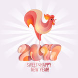 Sign New Year 2017 rooster in shape of candy on stick. Stock Photography