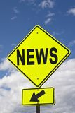 Sign NEWS. On a yellow road sign and blue sly Royalty Free Stock Image