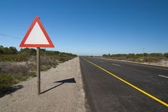 Sign next to road Royalty Free Stock Photo