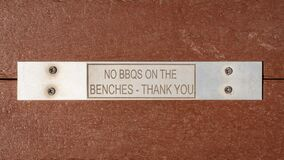 Sign: No BBQs on the benches - thank you