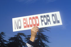 Sign �No blood for oil� at peace rally,  Los Angeles, California Royalty Free Stock Photography