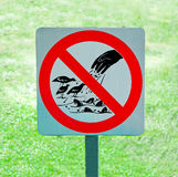 The sign of no feeding bird and fish. On green grass background Royalty Free Stock Photography