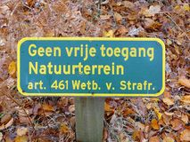 Sign `No free access, nature area` Dutch. Sign for `No free access, nature area` Dutch with warning for potential law enforcement stock images