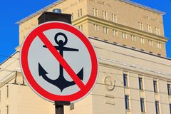 Sign no parking for vessels. Anchor with red diagonal line on a white background Royalty Free Stock Photography