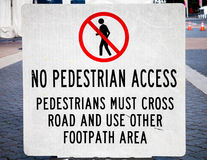Sign NO PEDESTRIAN ACCESS, PEDESTRIANS CROSS ROAD USE OTHER FOOT Royalty Free Stock Photography