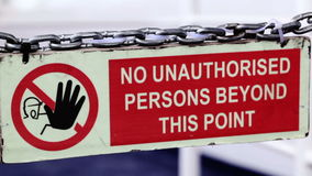 Sign - No unauthorized persons permitted beyond this point. stock video