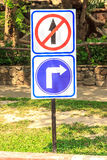 Sign not straight and please turn right. In garden for contral cars Royalty Free Stock Photography