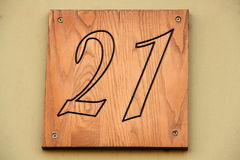 Sign 21. Number on a wooden plate Royalty Free Stock Photos