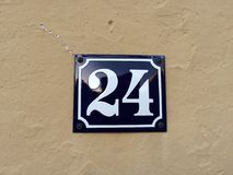 24 on a sign. The number 24 written on a blue sign royalty free stock images