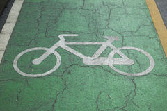 Sign off bicycle lanes in park. Bicycle lane royalty free stock photo