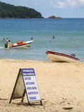 Sign offering boat tours to beaches nearby at Praia do Sono, popular beach in Paraty, Rio de Janeiro Stock Image