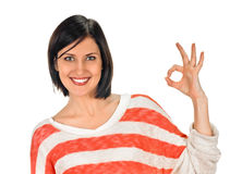 Young lady indicating ok sign. Young woman shows sign and symbol ok on white background Royalty Free Stock Photography