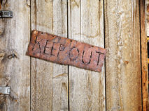 Sign on Old Door Stock Image