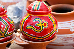 Sign OM on the red pot by the indian craftsmen Stock Photos