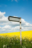Sign On Rapeseed Field Stock Photo