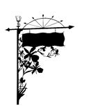 Sign with Ornate Orchid Detail. A tall silhouette of a sign with beautiful carved ornate details of flowers, orchids, arrows, and lantern Royalty Free Stock Photo