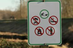 A sign outlining the rules of the trail. At a park Stock Photos