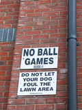 A sign outside up on the wall white and black saying no balls ga Royalty Free Stock Image