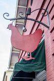 The Red Hen, front door. A sign over the front door of The Red Hen restaurant in  Lexington , Virginia is shaped like a chicken Stock Images