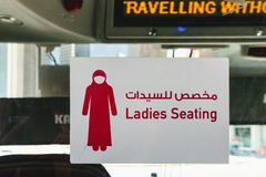 Sign over seats for lady in the bus, Doha, Qatar. Doha, Qatar - March 3, 2018: Sign over the seats for the lady in the tourist bus. The inscription in English royalty free stock photography