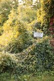 Sign in an overgrown place in Germany. It says Private property, no trespassing Royalty Free Stock Photo