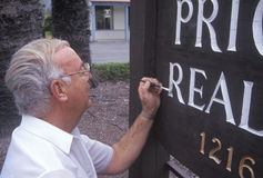 A sign painter touching up his work, Ojai, CA Stock Photo