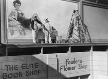 SIGN PAINTERS. (All persons depicted are no longer living and no estate exists. Supplier grants that there will be no model release issues Stock Photos
