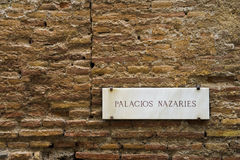 Sign Palacios Nazaríes. At a wall, Alhambra Granada, Spain Stock Photography