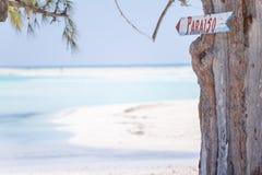 Sign on the paradisaic beach Stock Photography