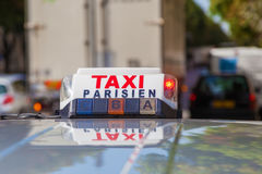 Sign of a Parisien taxi. Sign of a taxi in Paris, France Stock Photo