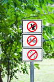 Sign in the park. Not allowed sign in the park Royalty Free Stock Photo