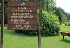 Sign at the park asking people not to feed waterfowl Royalty Free Stock Photos