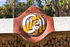 Sign of The Park Guell close-up. Park Guell is the famous park was designed by Antoni Gaudi and built in the years 1900 to 1914 Royalty Free Stock Photography