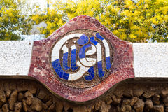 Sign of The Park Guell close-up. Park Guell is the famous park was designed by Antoni Gaudi and built in the years 1900 to 1914 Royalty Free Stock Photos