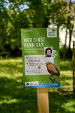 A sign in park invites people to identify a bird Stock Photos