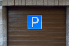 Sign `Parking`. Parking a car. Royalty Free Stock Photo