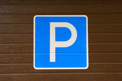 Sign `Parking`. Parking a car. Stock Images